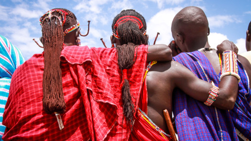 Kenyan Men with arms wrapped around each other